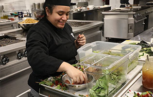 Culinary student preparing salad
